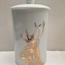 Buy the Little Weavers Art Gold Imperial Stag Storage Canister online at smithsofloughton.com